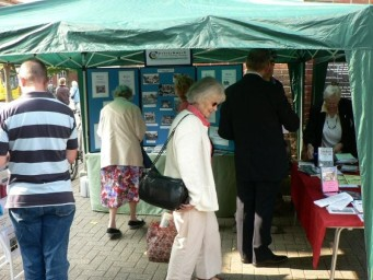 Manning our stall at community events