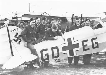British Airmen inspecting a German Bucker Aircraft   CHS Archive