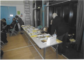 Volunteers Selling Books at an Evening Meeting