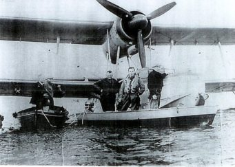 The boat which towed the Sea Otter. In the boat left to right Bert Bosbury, the pilot, and Bill Burbage