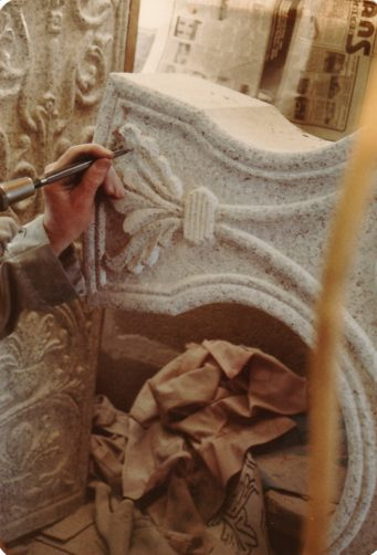 Granite sculptor Morley Eathorne working on detail in the Saxon Cross